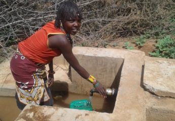 (WASH)Women enjoying fetching water at the water point in Mondi